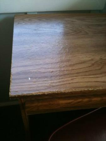 Buena Vista Hotel: The desk. Chipped throughout with a watermarked surface. Likely it was out in the rain.