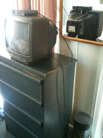 "Buena Vista Hotel: The ""digital cable."" Doesn't get FOX or other cable channels. Sits on broken dresser."