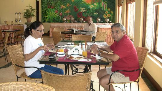 Coconut Grove: BREAKFAST ROOM WITH MR AFONSO KEEPING AN EYE OUT