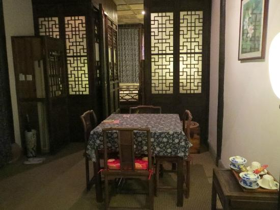 Pingjiang Lodge: looking into the bed area; on left is bathroom and on right is the tub