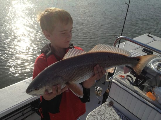 Son with red fish bild fr n awesome adventure charters for Red fish hilton head sc