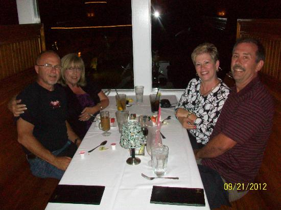 Good friends enjoying dinner at the Tale of the Whale