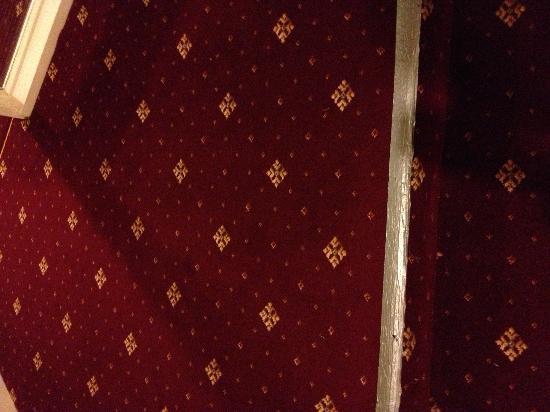 The Glebe Hotel: Duct tape on corridor carpet on step