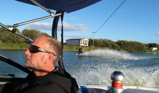 "Action Watersports: Simon ""Steady Hand"" Raine at the helm!"