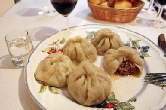 pirosmani : Khinkali....meat stuffed purses of dough...similar to Polish Pierogi.