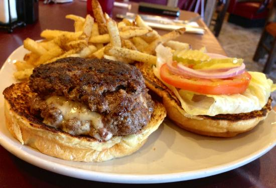 Traveller's Cafe : Traveller's Stuffed Hamburger wit havarti oozing out and a side of fries.