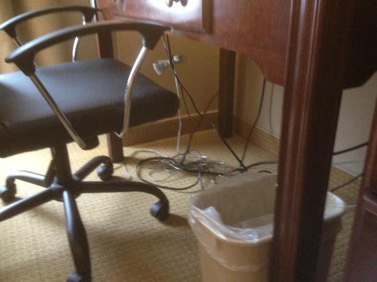 Comfort Suites Airport: Tangled wad of wires/cords under work desk