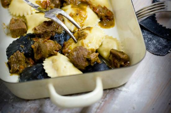 Pula, Croatia: Black and white Labinski krafi, traditional Istrian ravioli