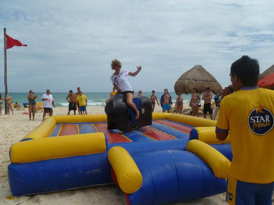 IBEROSTAR Paraíso Del Mar: Mechanical bull riding on the beach