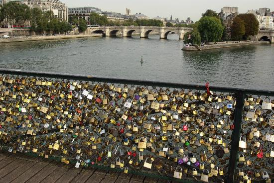 """Paris Urban Adventures: The """"love-locks"""" of Paris are back on the city's bridges after they mysteriously disappeared ..."""