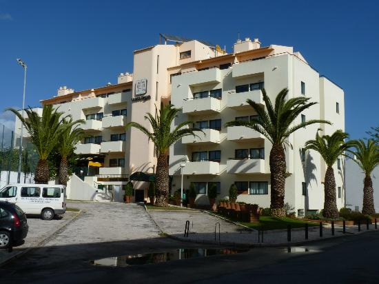 Aparthotel Olhos d'Agua, main entrance & small car park from south in Rua da Torre da Medronheir