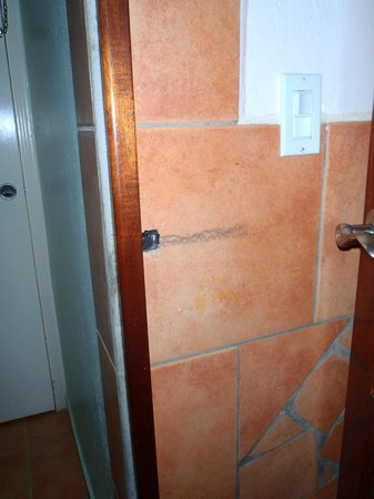 Mary's Boon Beach Hotel and Spa: Bathroom door won't close, hole in wall