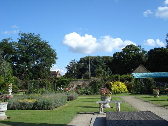 Sunbury, UK: View from the back of garden looking towards front entrance with cafe on right