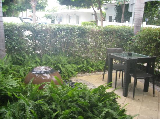 Orchid Key Inn: just outside our door - a small table for smokers or just relaxing