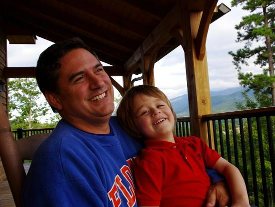 Elk Springs Resort: Husband and son, post-giggles on the deck with the Smoky Mountains as a backdrop