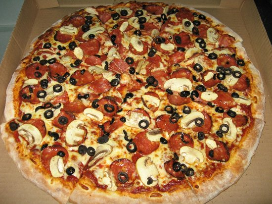 """Ronny's Pizza: The """"Cruiser"""" Pepperoni, Mushrooms and Black Olives."""
