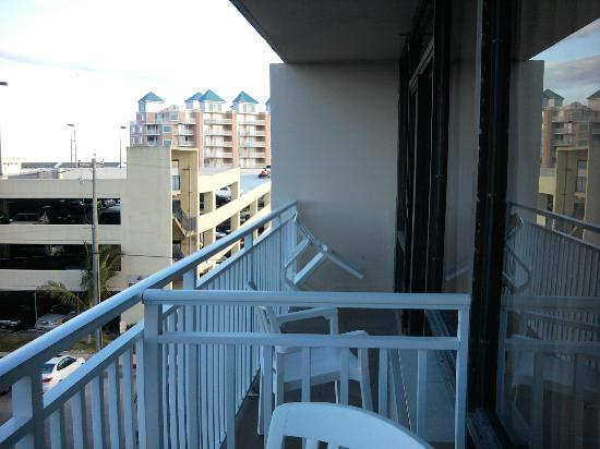Carousel Resort Hotel & Condominiums: Balcony with next door room balcony on right. Parking garage also shown