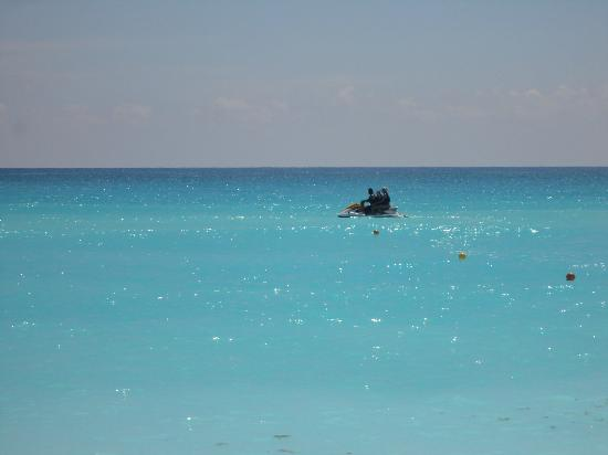 Crown Paradise Club Cancun: jetski out to boat to parasail