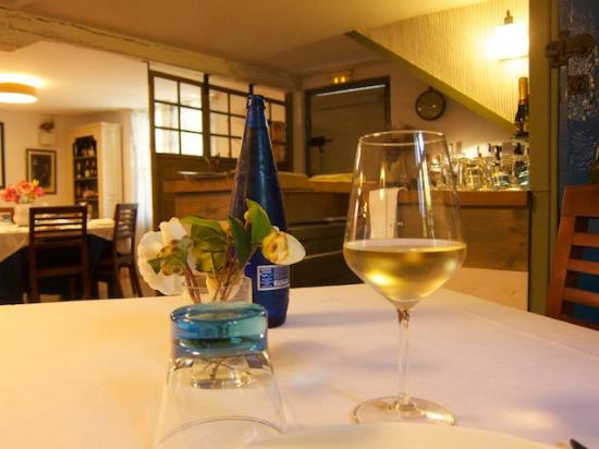 Meson Arropain Restaurante: A glass of Txakoli, some water, and a cosy room