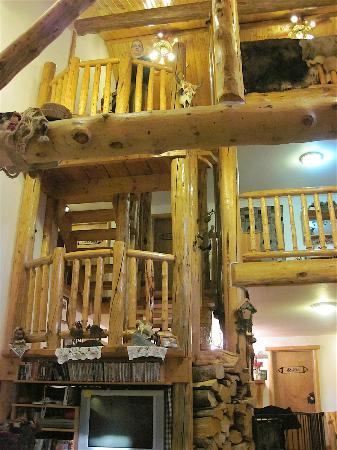 Skyline Guest Ranch and Guide Service: View of stairway and upper floor from inside living room.