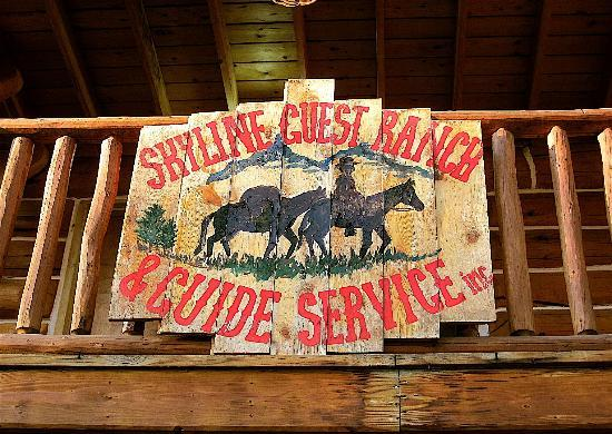 ‪‪Skyline Guest Ranch and Guide Service‬: View of sign above front door of ranch.