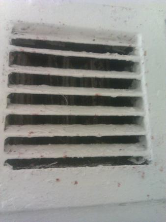 Metro Apartments: filthy air vent above shower in bathroom