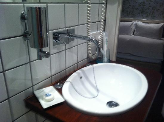 Portixol Hotel and Restaurant: Our cool little bathroom sink and view to bedroom