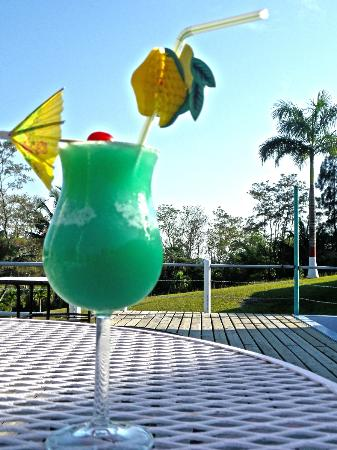 Rumors Resort: sip on a signiture coctail in the openness of our scenic deck