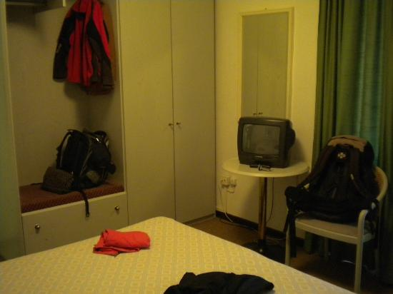 Calipso Hotel: much closet space / small TV on small table