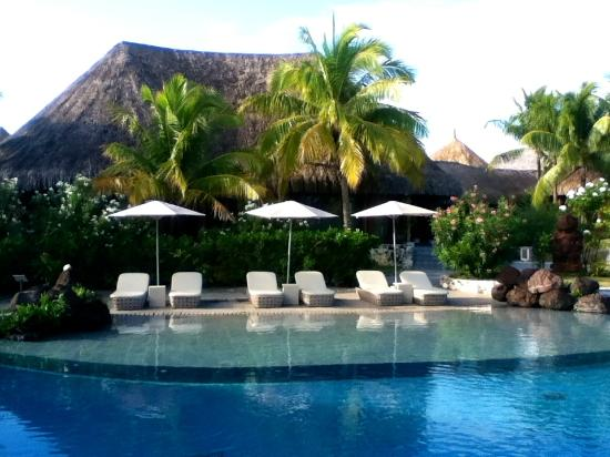 The St. Regis Bora Bora Resort : Lounge chairs at the main pool.