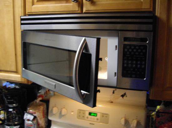 The Summit Condominiums: Microwave door falling off hinges unit 1201