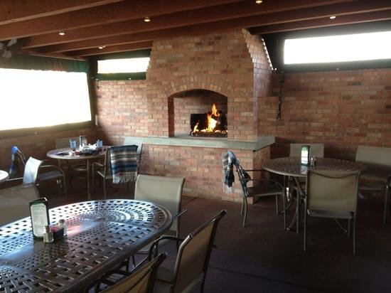 Covered outdoor patio with fireplace picture of salsa for El salas restaurante