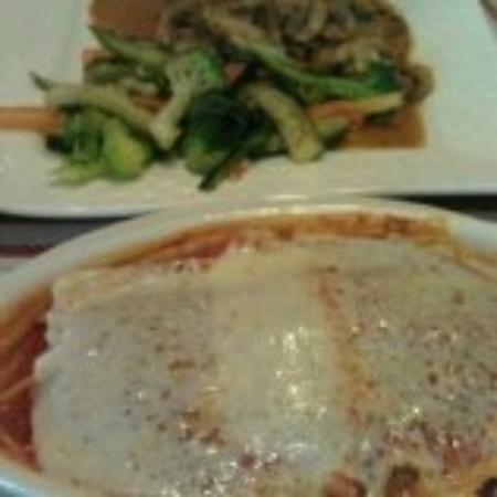 Sal's By Victor: Lasagna on one plate & grilled chicken with veggies on the other.