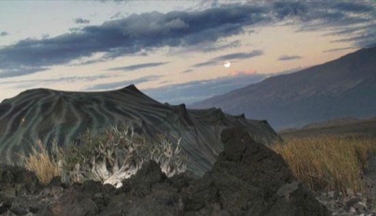 Ngare Sero - Lake Natron Camp: Moon rise over Mt. Gelai with the Bedu tent in the forground.