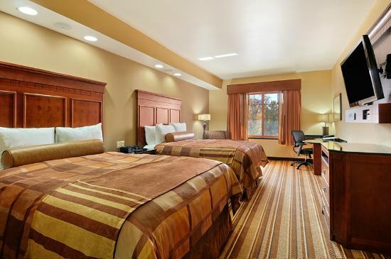 Best Western Premier KC Speedway Inn U0026 Suites: Double Queens Room With Flat  Screen Tvs