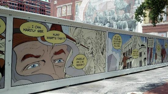 """""""The Largest Comic Strip in Texas"""" around the construction in Sundance Square."""