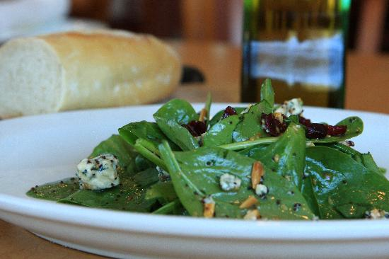Riganato Old World Grille : Fresh Spinach, Maytag Bleu Cheese, Toasted Almonds, Cranberries, House Poppyseed Dressing.