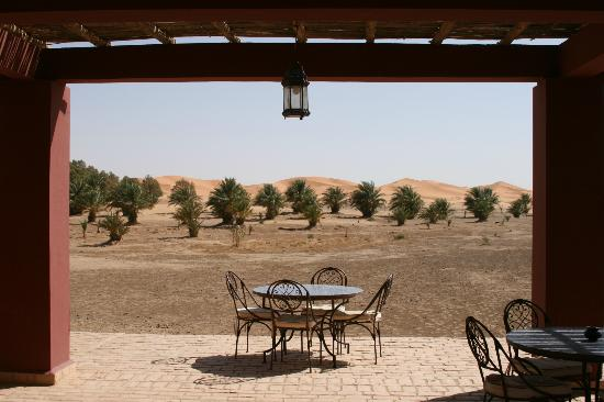 Dar El Janoub: The dining terrace with sand dunes in the background.