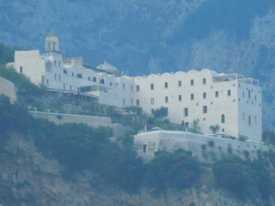 Monastero Santa Rosa Hotel & Spa: MSR - up on the cliff - as we took hydrofoil in from Capri