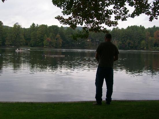 Pine Point Cottages and Motel: My husband enjoying a little fishing<3