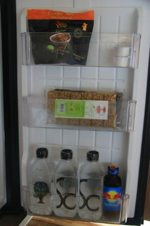 Sofitel So Bangkok: mini fridge with free water and juices and red bull