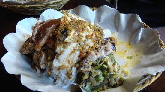 Warung Babi Guling Ibu Oka 3: With everything + extra meat on the backround