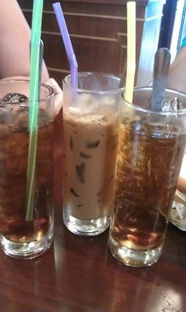 Dinh Phat Hotel: Drinks provided during breakfast...Lipton Iced Teas and Cold Coffee with Milk (middle glass)