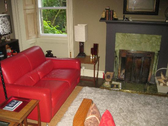 Glenardoch House: sitting room with fireplace