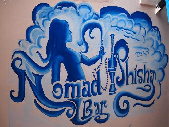 Nomad Shisha Bar: Our logo painted on the wall by a local artist