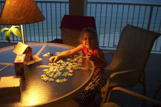 Summer House on Romar Beach: Sitting on the Balcony on a rainy night, working a puzzle