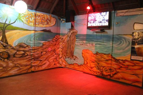 Frasers On Rainbow Beach: A mural of Indian Head at Fraser Island. Perfect for this setting