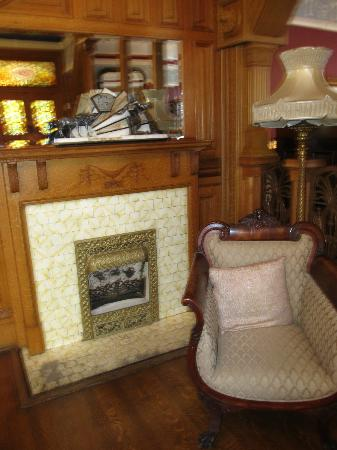 Chateau Tivoli Bed & Breakfast: One of the lobby fireplaces