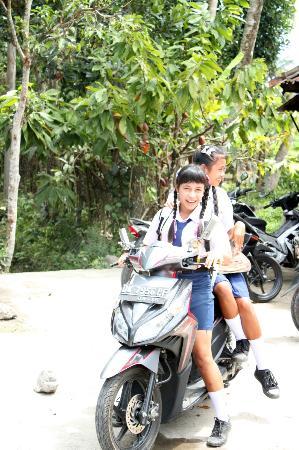 Bali Bike Baik Cycling Tours: School girls riding motor bikes!