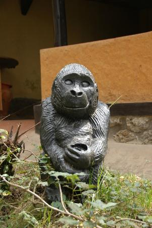 Sabyinyo Silverback Lodge: this `mascot`hand carved Mountain gorilla greets guests at the vehicle park